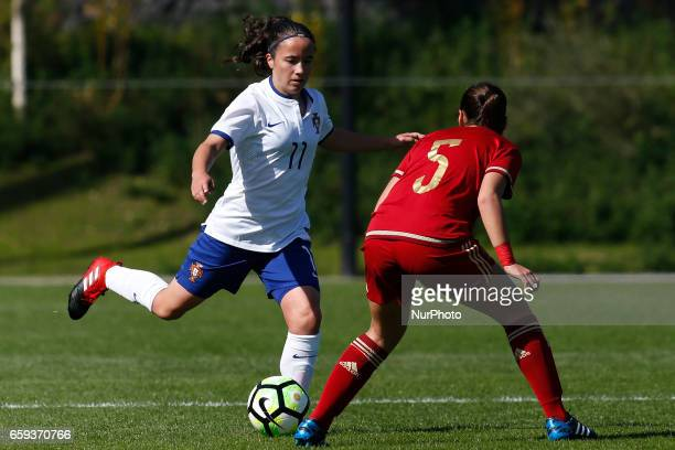 Ana Isabel Teles of Portugal and Juana Torres Pedraza of Spain during the UEFA U17 Women's Championship Qualifier match between Spain and Portugal at...