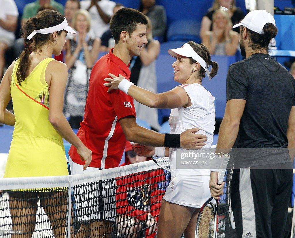 Ana Ivanovic (left) and Novak Djokovic (Second left) congratulate Anabel Medina Garrigues (third left) and Fernando Verdasco (right) of Spain after they won the Hopman Cup in their mixed doubles final match on day eight of the Hopman Cup tennis tournament in Perth on January 5, 2013. AFP PHOTO/Tony ASHBY IMAGE
