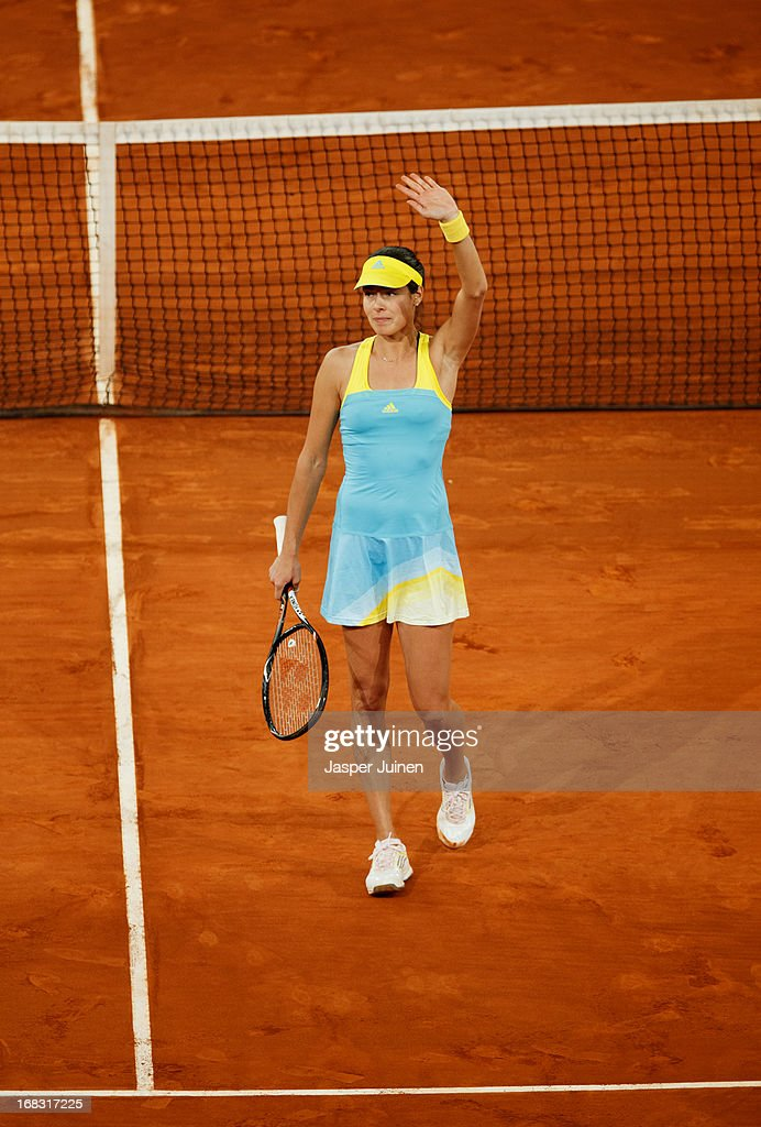 <a gi-track='captionPersonalityLinkClicked' href=/galleries/search?phrase=Ana+Ivanovic&family=editorial&specificpeople=542118 ng-click='$event.stopPropagation()'>Ana Ivanovic</a> of Serbia acknowledges the crowd after winning her match against Laura Robson of Great Britain on day five of the Mutua Madrid Open tennis tournament at the Caja Magica on May 8, 2013 in Madrid, Spain.
