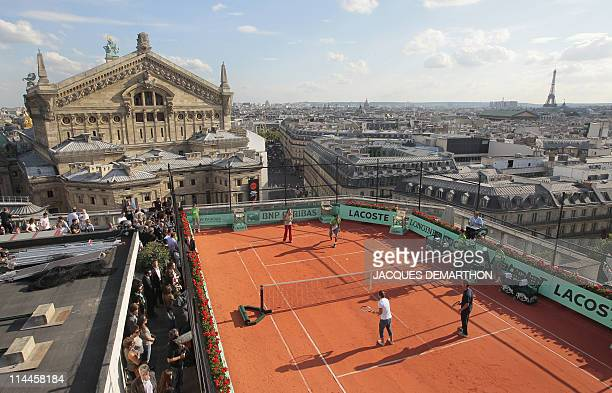 Ana Ivanovic of Serbia and JoWilfrid Tsonga of France play an exhibition match against Samantha Stosur of Australia and Richard Gasquet of France on...
