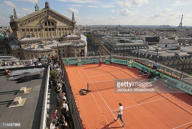 Ana Ivanovic of Serbia and Samantha Stosur of Australia play an exhibition match on May 19 2011 on the roof of the Galeries Lafayette department...