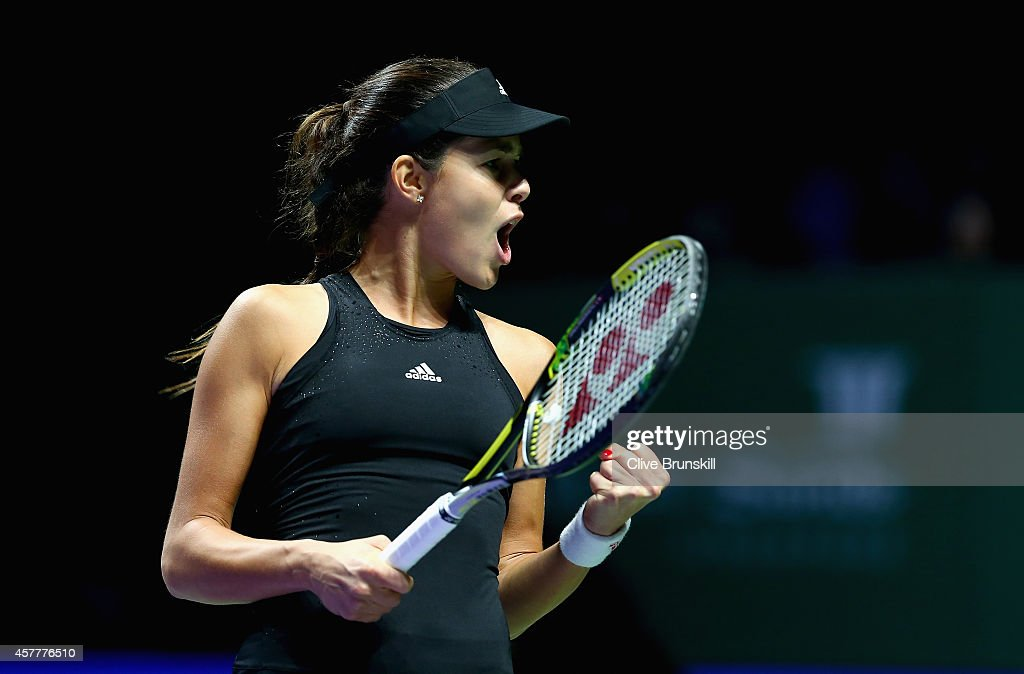 Ana Ivanovic of Serbia celebrates a point in the first set against Simona Halep of Romania in their round robin match during the BNP Paribas WTA Finals at Singapore Sports Hub on October 24, 2014 in Singapore.