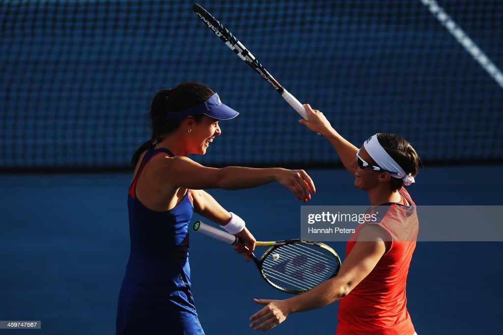 <a gi-track='captionPersonalityLinkClicked' href=/galleries/search?phrase=Ana+Ivanovic&family=editorial&specificpeople=542118 ng-click='$event.stopPropagation()'>Ana Ivanovic</a> of Serbia celebrates with <a gi-track='captionPersonalityLinkClicked' href=/galleries/search?phrase=Kirsten+Flipkens&family=editorial&specificpeople=598749 ng-click='$event.stopPropagation()'>Kirsten Flipkens</a> of Belgium after winning their doubles match against Irina Falconi of the USA and Eva Hrdinova of the Czech Republic during day one of the ASB Classic at ASB Tennis Centre on December 30, 2013 in Auckland, New Zealand.