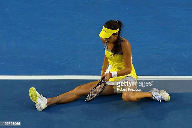Ana Ivanovic of Serbia falls onto the court in her fourth round match against Agnieszka Radwanska of Poland during day seven of the 2013 Australian...