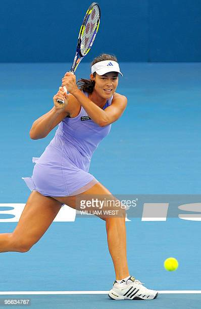 Ana Ivanovic of Serbia hits a backhand return during her loss to Justine Henin of Belgium in their semifinal match at the Brisbane International...