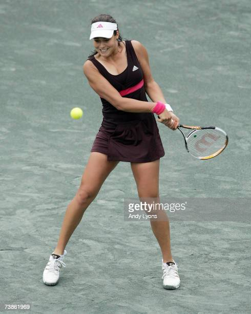 Ana Ivanovic of Serbia hits a return in her 60 67 64 victory over Gisela Dulko of Argentina during the Family Circle Cup at the Family Circle Tennis...