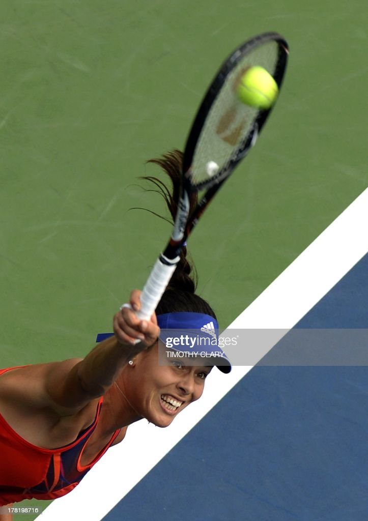 Ana Ivanovic of Serbia hits the ball against Anna Tatishvili of Georgia during their 2013 US Open women's singles match at the USTA Billie Jean King National Tennis Center in New York on August 27 , 2013. AFP PHOTO / TIMOTHY CLARY