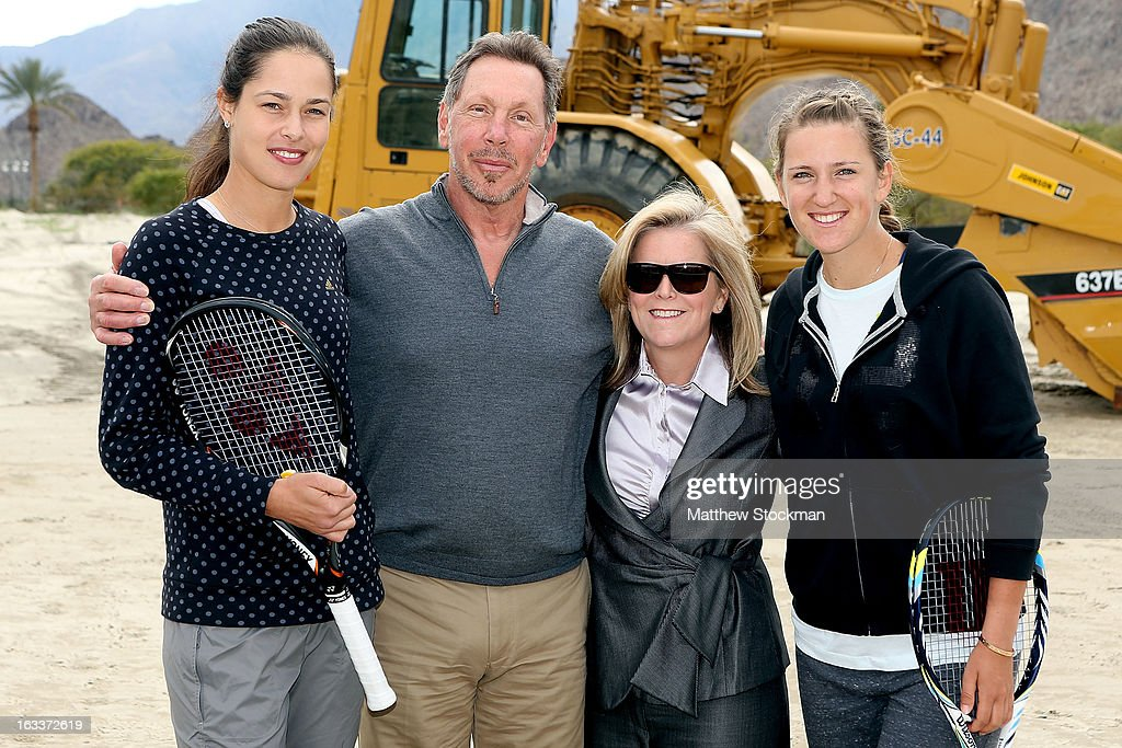 Ana Ivanovic of Serbia, Larry Ellison, tournament owner and CEO of Oracle, Stacey Allaster, CEO of the WTA and Victoria Azarenka of Belarus pose for photographers after participating in the ground breaking ceremony for the Indian Wells Tennis Garden expansion during the BNP Paribas Open at the Indian Wells Tennis Garden on March 8, 2013 in Indian Wells, California.