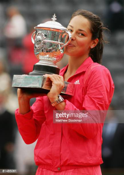 Ana Ivanovic of Serbia lifts the trophy following her victory during the Women's Singles Final match against Dinara Safina of Russia on day fourteen...
