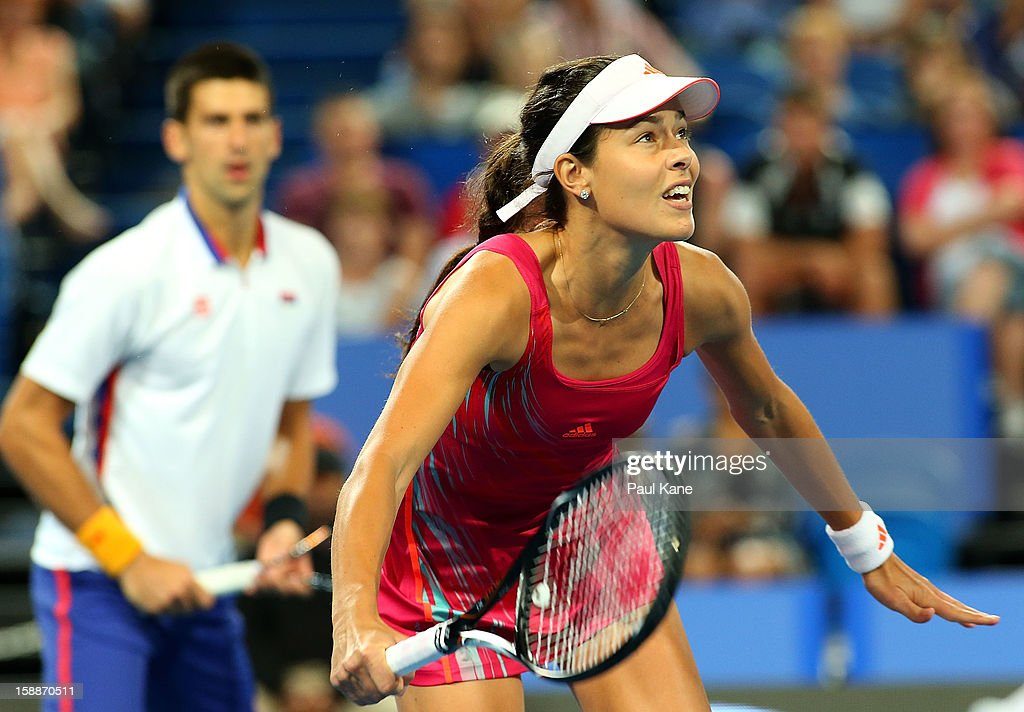 Ana Ivanovic of Serbia looks to return a shot in the mixed doubles match partnered with Novak Djokovic against Ashleigh Barty and Bernard Tomic of Australia during day five of the Hopman Cup at Perth Arena on January 2, 2013 in Perth, Australia.
