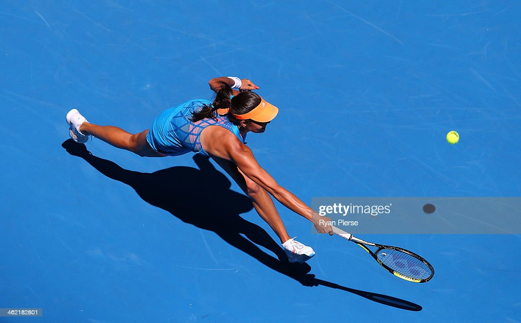 <a gi-track='captionPersonalityLinkClicked' href=/galleries/search?phrase=Ana+Ivanovic&family=editorial&specificpeople=542118 ng-click='$event.stopPropagation()'>Ana Ivanovic</a> of Serbia plays a forehand in her first round match against Kiki Bertens of the Netherlands during day one of the 2014 Australian Open at Melbourne Park on January 13, 2014 in Melbourne, Australia.