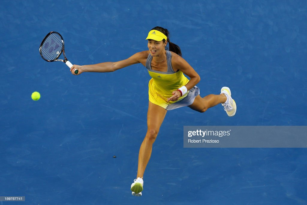 Ana Ivanovic of Serbia plays a forehand in her fourth round match against Agnieszka Radwanska of Poland during day seven of the 2013 Australian Open at Melbourne Park on January 20, 2013 in Melbourne, Australia.