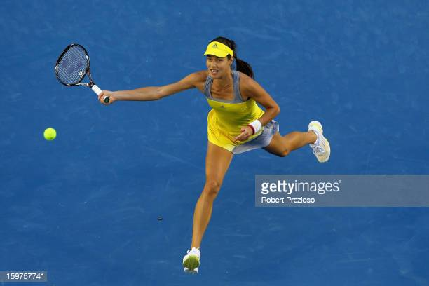 Ana Ivanovic of Serbia plays a forehand in her fourth round match against Agnieszka Radwanska of Poland during day seven of the 2013 Australian Open...