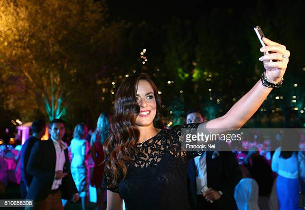 Ana Ivanovic of Serbia pose for a selfie at the players party during day two of the WTA Dubai Duty Free Tennis Championship at the Dubai Duty Free...