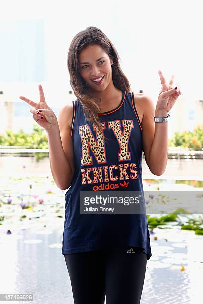 Ana Ivanovic of Serbia poses for a TV interview during previews for the WTA Finals at the ArtScience Museum on October 19 2014 in Singapore