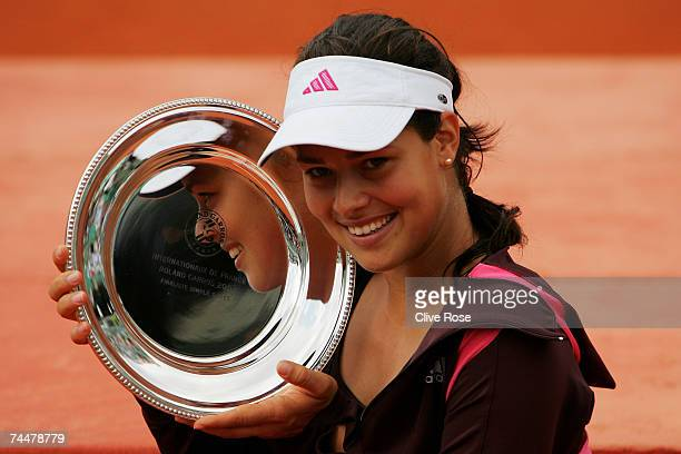 Ana Ivanovic of Serbia poses with the runners up trophy after losing to Justine Henin of Belgium in the Women's Singles Final on day fourteen of the...