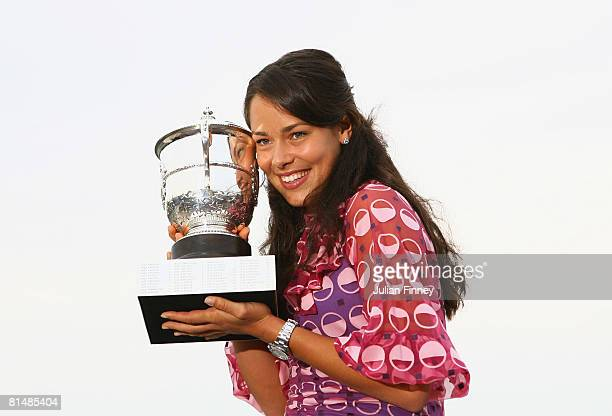 Ana Ivanovic of Serbia poses with the the trophy following her victory during the Women's Singles Final match against Dinara Safina of Russia on day...