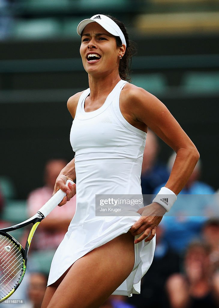 Ana Ivanovic of Serbia reacts after winning her Ladies' Singles first round match against Francesca Schiavone of Italy on day two of the Wimbledon Lawn Tennis Championships at the All England Lawn Tennis and Croquet Club at Wimbledon on June 24, 2014 in London, England.