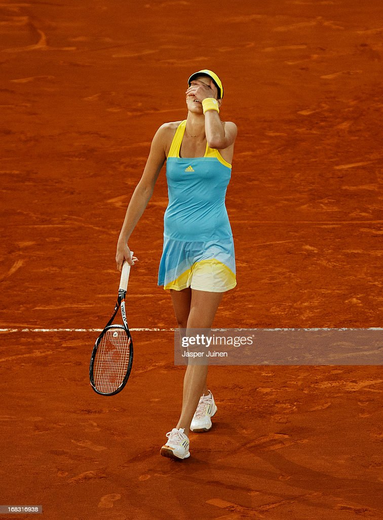 <a gi-track='captionPersonalityLinkClicked' href=/galleries/search?phrase=Ana+Ivanovic&family=editorial&specificpeople=542118 ng-click='$event.stopPropagation()'>Ana Ivanovic</a> of Serbia reacts at matchpoint after winning her match against Laura Robson of Great Britain on day five of the Mutua Madrid Open tennis tournament at the Caja Magica on May 8, 2013 in Madrid, Spain.