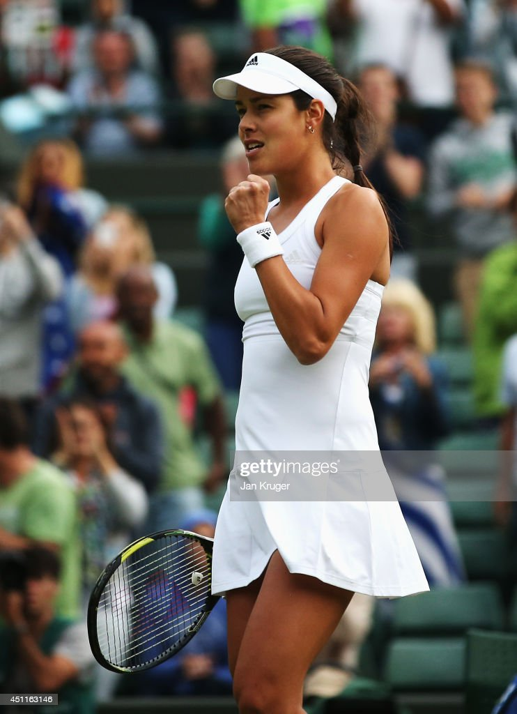 Ana Ivanovic of Serbia reacts during her Ladies' Singles first round match against Francesca Schiavone of Italy on day two of the Wimbledon Lawn Tennis Championships at the All England Lawn Tennis and Croquet Club at Wimbledon on June 24, 2014 in London, England.