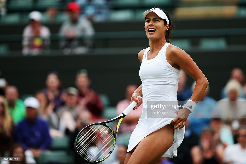 <a gi-track='captionPersonalityLinkClicked' href=/galleries/search?phrase=Ana+Ivanovic&family=editorial&specificpeople=542118 ng-click='$event.stopPropagation()'>Ana Ivanovic</a> of Serbia reacts during her Ladies' Singles first round match against Francesca Schiavone of Italy on day two of the Wimbledon Lawn Tennis Championships at the All England Lawn Tennis and Croquet Club at Wimbledon on June 24, 2014 in London, England.