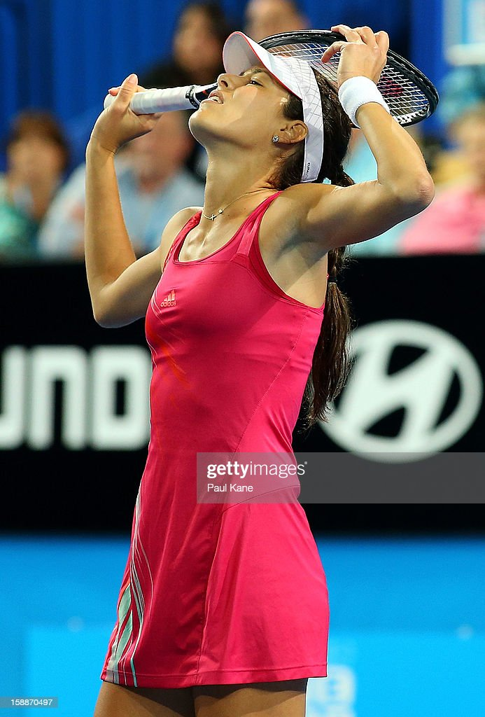Ana Ivanovic of Serbia reacts to missing a shot in the mixed doubles match partnered with Novak Djokovic against Ashleigh Barty and Bernard Tomic of Australia during day five of the Hopman Cup at Perth Arena on January 2, 2013 in Perth, Australia.