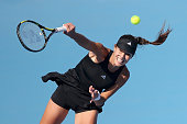 Ana Ivanovic of Serbia serves against Belinda Bencic of Switzerland during day three of the China Open at the China National Tennis Center on...