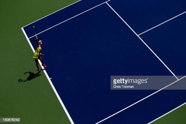 Ana Ivanovic of Serbia serves against Elina Svitolina of Ukraine during their women's singles first round match on Day Two of the 2012 US Open at the...