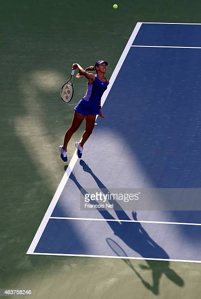 Ana Ivanovic of Serbia serves against Karolina Pliskova of the Czech Republic during day four of the WTA Dubai Duty Free Tennis Championship at the...