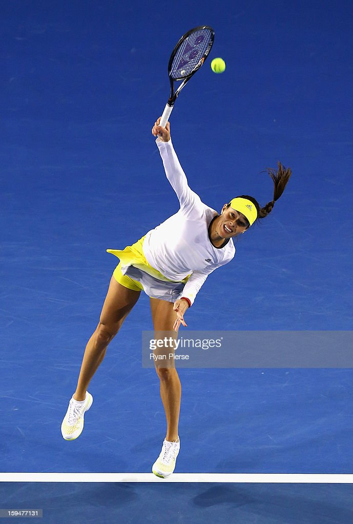 Ana Ivanovic of Serbia serves during her first round match against Melinda Czink of Hungary during day one of the 2013 Australian Open at Melbourne Park on January 14, 2013 in Melbourne, Australia.
