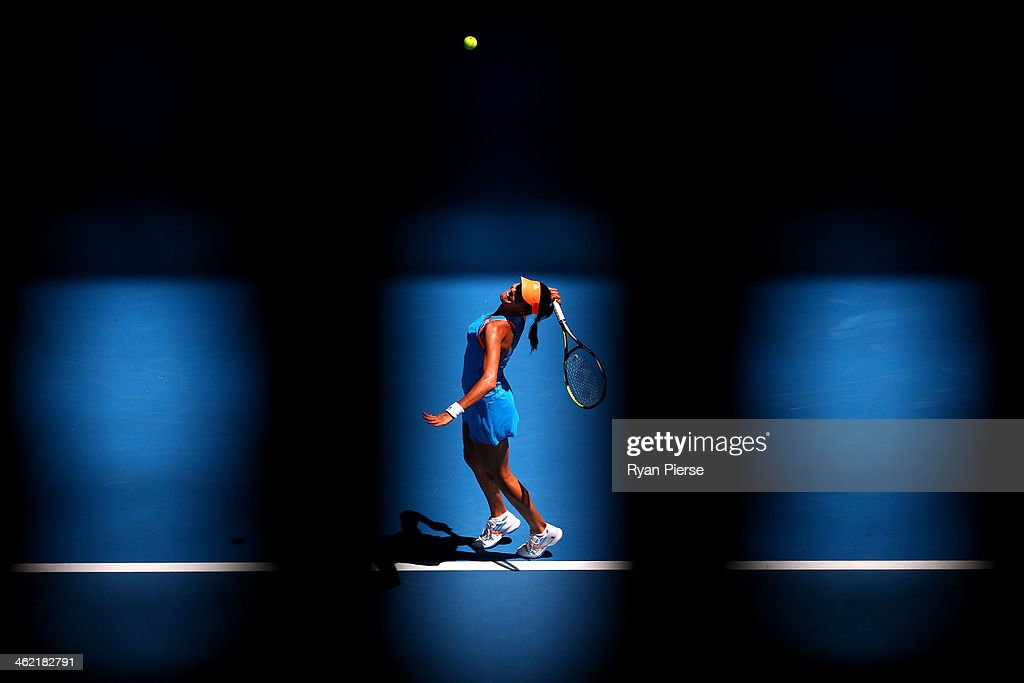 <a gi-track='captionPersonalityLinkClicked' href=/galleries/search?phrase=Ana+Ivanovic&family=editorial&specificpeople=542118 ng-click='$event.stopPropagation()'>Ana Ivanovic</a> of Serbia serves in her first round match against Kiki Bertens of the Netherlands during day one of the 2014 Australian Open at Melbourne Park on January 13, 2014 in Melbourne, Australia.