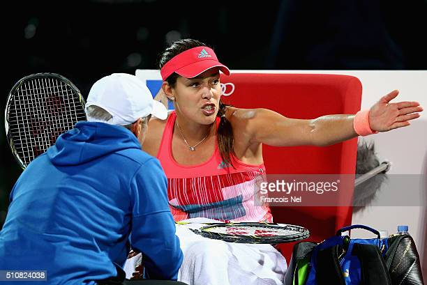 Ana Ivanovic of Serbia talks with coach Nigel Sears in her match against Simona Halep of Romania during day three of the WTA Dubai Duty Free Tennis...
