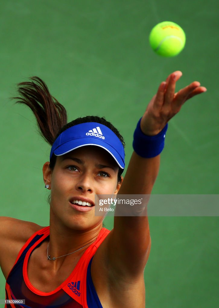 Ana Ivanovic of Serbia tosses the ball in the air to as she serves during her victory in the women's singles first round match against Anna Tatishvili of Georgia on Day Two of the 2013 US Open at USTA Billie Jean King National Tennis Center on August 27, 2013 in the Flushing neighborhood of the Queens borough of New York City.