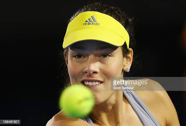 Ana Ivanovic of Serbia watches the ball during her first round match against Melinda Czink of Hungary during day one of the 2013 Australian Open at...