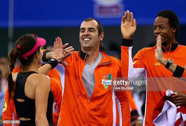 Ana Ivanovic of the Indian Aces celebrates with Cedric Pioline and her team after her victory against Kristina Mladenovic of the UAE Royals during...