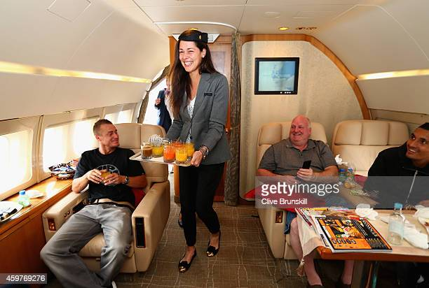 Ana Ivanovic of the Indian Aces takes on the roll of stewardess as she serves drinks to the players on a private jet from Manila to Singapore prior...
