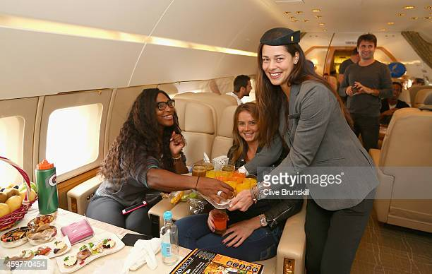 Ana Ivanovic of the Indian Aces takes on the roll of stewardess as she serves drinks to Serena Williams and Daniela Hantuchova of the Singapore...
