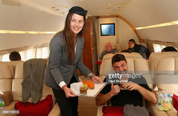 Ana Ivanovic of the Indian Aces takes on the roll of stewardess as she serves drinks to Goran Ivanisevic of the UAE Royals on a private jet from...