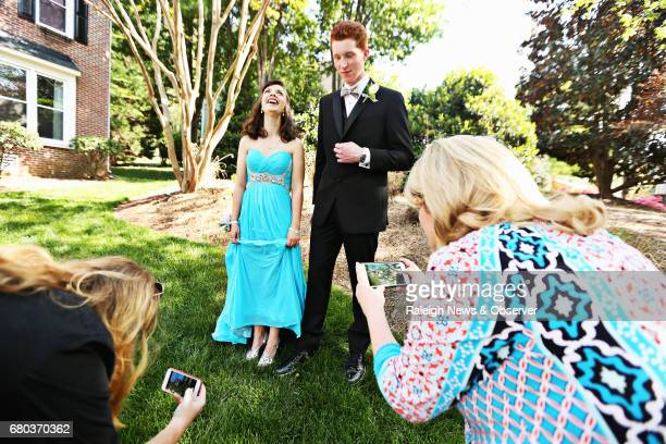 Ana Johnson center left lets out a big laugh beside her prom date Jacob Hodgins center right as they are surrounded by family members scrambling to...