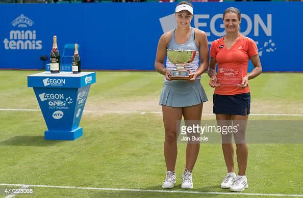 Ana Konjuh of Croatia and Monica Niculescu of Romania pose during trophy presentation with the Elena Baltacha Trophy on day eight of the WTA Aegon...