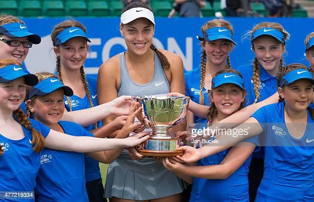 Ana Konjuh of Croatia celebrates winning the Aegon Open Nottingham with ball girl's and the Elena Baltacha Trophy on day eight of the WTA Aegon Open...