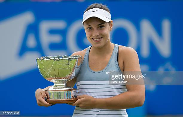 Ana Konjuh of Croatia celebrates winning the Aegon Open Nottingham against Monica Niculescu of Romania with the Elena Baltacha Trophy on day eight of...