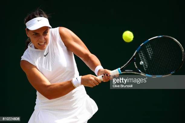 Ana Konjuh of Croatia plays a backhand during the Ladies Singles third round match againgst Dominika Cibulkoba of Slovakia on day five of the...