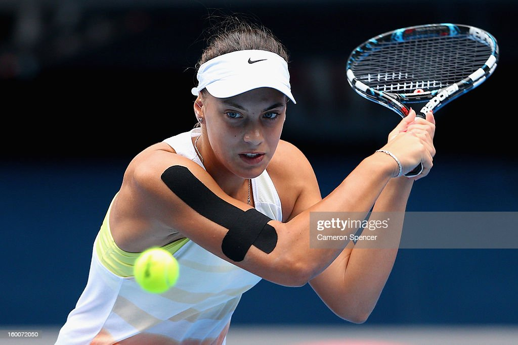 Ana Konjuh of Croatia plays a backhand in her junior girls' final match against Katerina Siniakova of the Czech Republic during the 2013 Australian Open Junior Championships at Melbourne Park on January 26, 2013 in Melbourne, Australia.