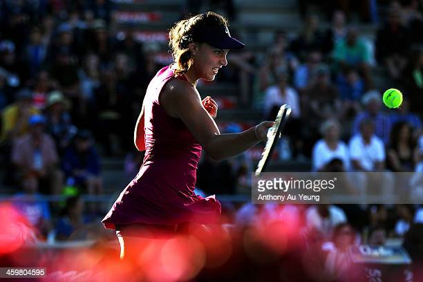 Ana Konjuh of Croatia plays a forehand against Roberta Vinci of Italy during day two of the ASB Classic at ASB Tennis Centre on December 31 2013 in...