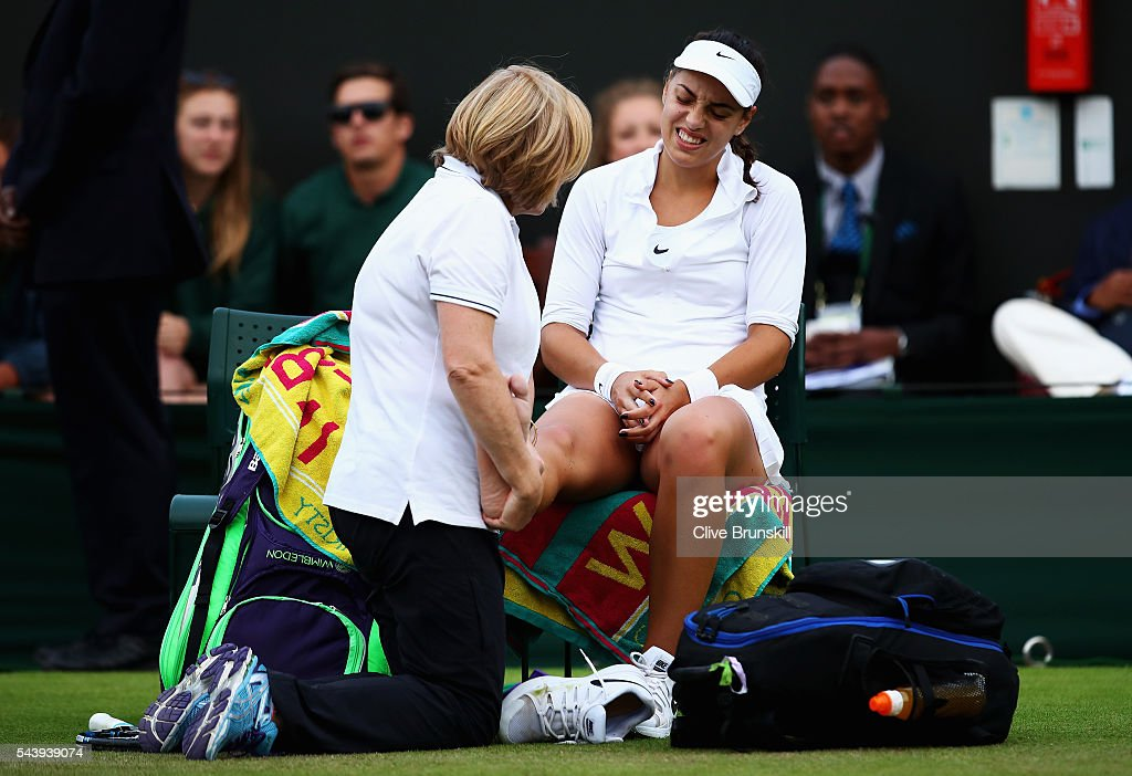 Ana Konjuh of Croatia receives treatment on her ankle during the Ladies Singles second round match against Agnieszka Radawanska of Poland on day four of the Wimbledon Lawn Tennis Championships at the All England Lawn Tennis and Croquet Club on June 30, 2016 in London, England.
