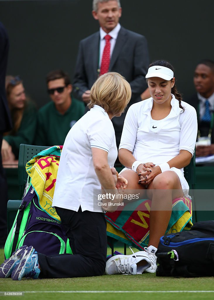 <a gi-track='captionPersonalityLinkClicked' href=/galleries/search?phrase=Ana+Konjuh&family=editorial&specificpeople=10126179 ng-click='$event.stopPropagation()'>Ana Konjuh</a> of Croatia receives treatment on her ankle during the Ladies Singles second round match against Agnieszka Radawanska of Poland on day four of the Wimbledon Lawn Tennis Championships at the All England Lawn Tennis and Croquet Club on June 30, 2016 in London, England.