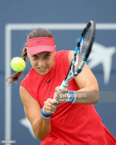 Ana Konjuh of Croatia returns a shot to Garbine Muguruza of Spain during their quarterfinal match on Day 5 of the Bank of the West Classic at...