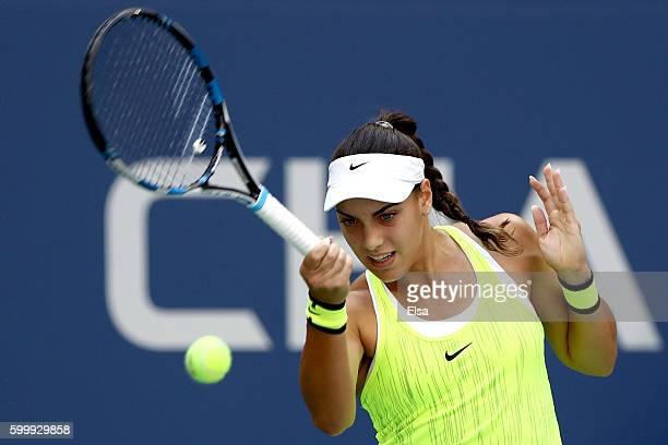 Ana Konjuh of Croatia returns a shot to Karolina Pliskova of the Czech Republic during their Women's Singles Quarterfinal match on Day Ten of the...
