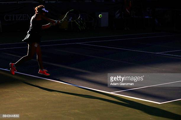 Ana Konjuh of Croatia returns a shot to Kayla Day of the United States during their match on day 2 of the Connecticut Open at the Connecticut Tennis...